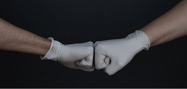 2 gloved fists