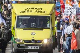 London Ambulance surrounded by crowds of people