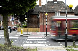 A bus drive across a pedestrian crossing