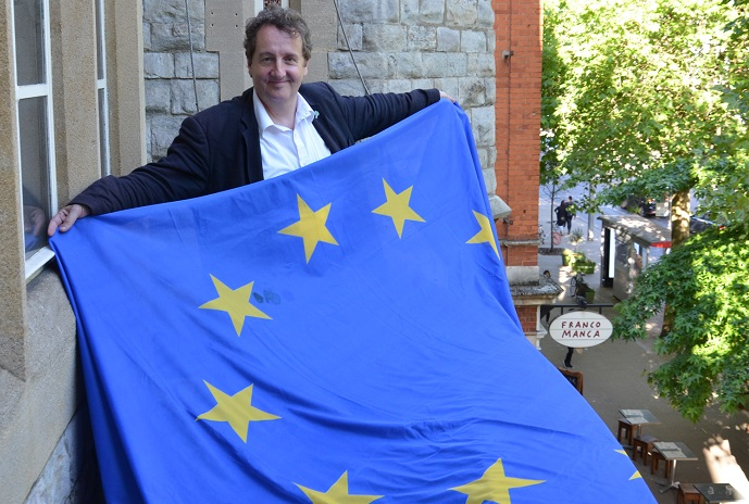 Cllr Julian Bell, leader of the council, with EU flag