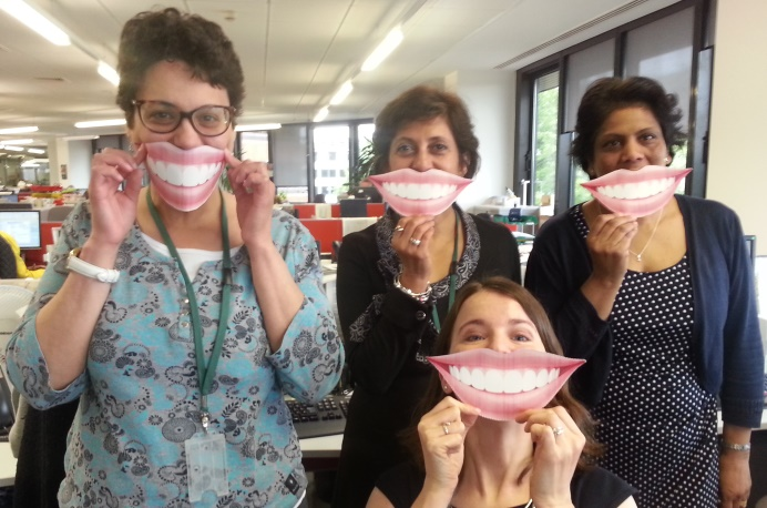 Public health team demonstrate their 'smiley'