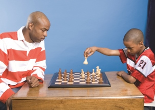 Man and boy playing chess