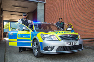 Police officers and council staff working together